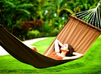 Young beautiful woman in hammock, Bali, Indonesia; Shutterstock ID 92736865; PO: aol; Job: production; Client: drone