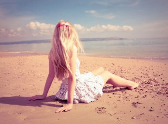 6999814-lonely-girl-sitting-on-beach