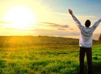 happy man with hands up on sunset background; Shutterstock ID 100173191; PO: aol; Job: production; Client: drone
