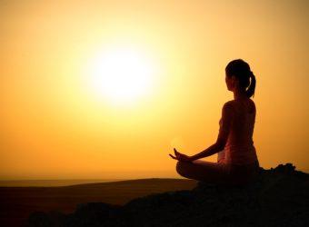 Girl practicing yoga at sunrise, outdoor sun
