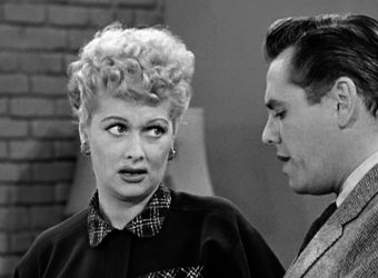 American comedienne and actress Lucille Ball (1911 - 1989), as Lucy Ricardo, listens to Cuban-born American actor and musician Desi Arnaz (born Desiderio Alberto Arnaz y De Acha III, 1917 - 1986), as Ricky Ricardo, pours a cup of coffee in the kitchen in a scene from an episode of the television comedy 'I Love Lucy' entitled 'Job Switching,' Los Angeles, California, May 30, 1952. The pair were married both off-screen and as their characters. The episode was originally broadcast as the opening episode of the show's second season, on September 15, 1952. (Photo by CBS Photo Archive/Getty Images)