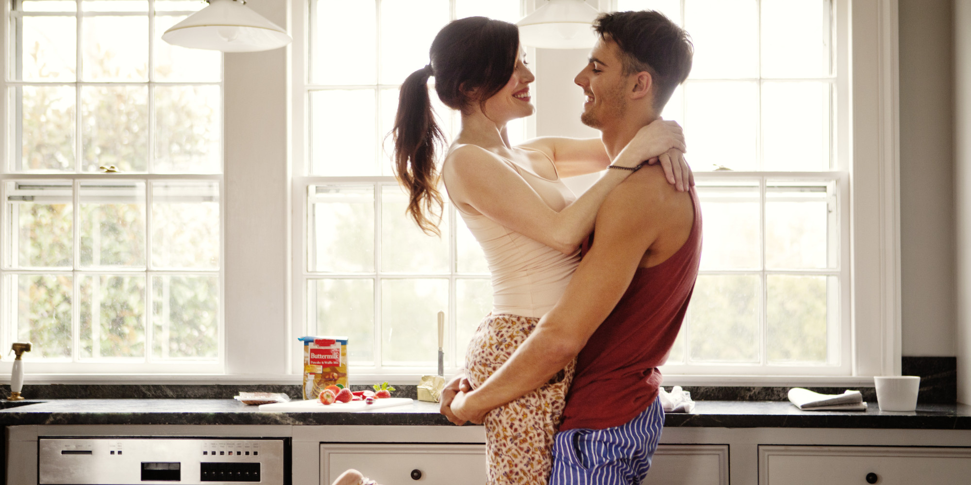 Couple flirting while making breakfast