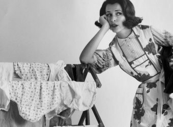 Young woman leaning on a drying rack